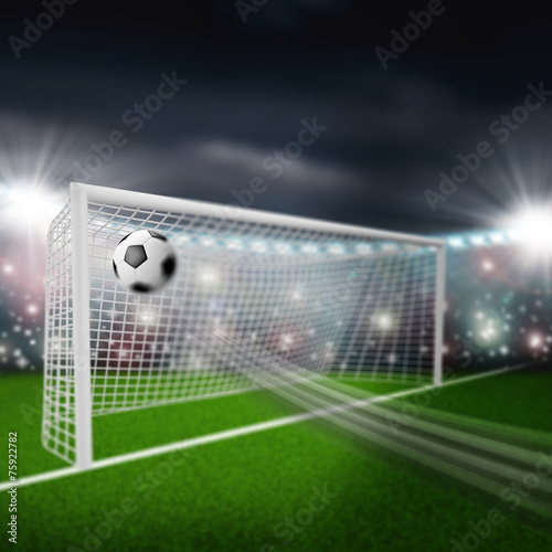 soccer ball flies into the goal - 75922782
