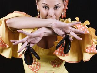 Women, dressed in flamenco dancing