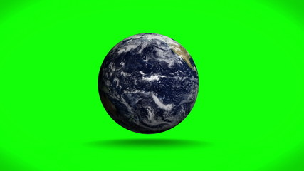 Earth spinning on green background