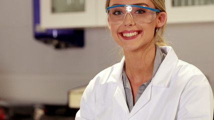 Pretty scientist smiling at the camera