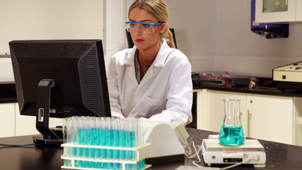 Scientist using computer for her research