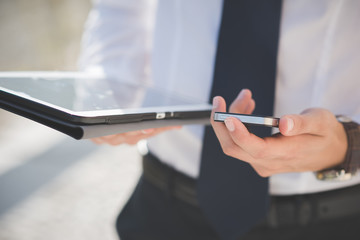 close up businessman man hand using tablet and smart phone