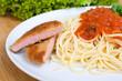 Leinwanddruck Bild - Pasta mit Tomatensoße und Jägerschnitzel