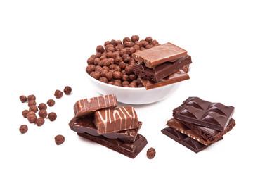 Шоколад, конфеты и роза на белом фоне