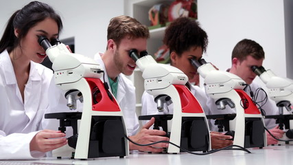 Medical students working with microscopes