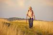 canvas print picture - Wanderer mit Stock auf Wiese