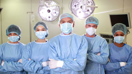 Surgical team looking at the camera in operating theater