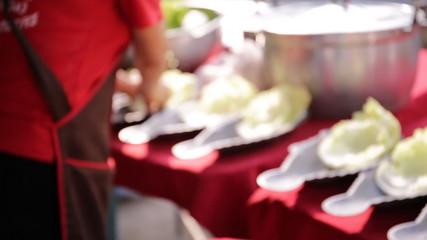 Restaurant kitchen woman preparing fish dishes