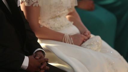 groom sit next to bride on wedding in catholic church