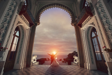 Wedding couple in the palace. Stand back in front of the sunset.