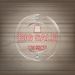 Big sale vector glass label on a wooden background