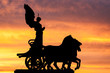 Rome at dusk: silhouette of the goddess Victoria. - 75930358
