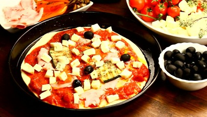 Chef Hand Making Italian Pizza