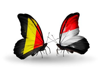 Two butterflies with flags Belgium and Yemen