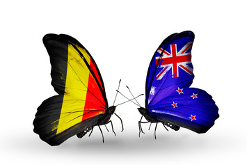 Two butterflies with flags Belgium and New Zealand
