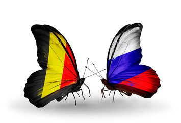 Two butterflies with flags Belgium and Russia