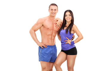 An athletic young couple posing together