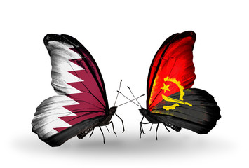 Two butterflies with flags Qatar and Angola