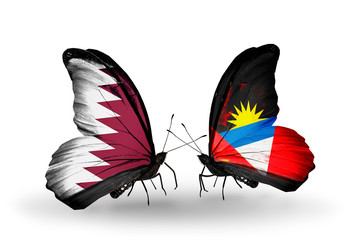Two butterflies with flags Qatar and Antigua and Barbuda