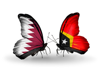 Two butterflies with flags Qatar and East Timor