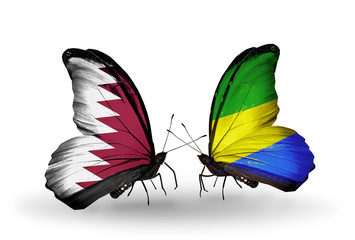 Two butterflies with flags Qatar and Gabon