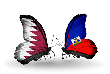 Two butterflies with flags Qatar and Haiti
