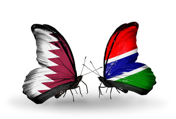 Two butterflies with flags Qatar and Gambia