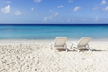 Sunbeds at white sand tropical beach