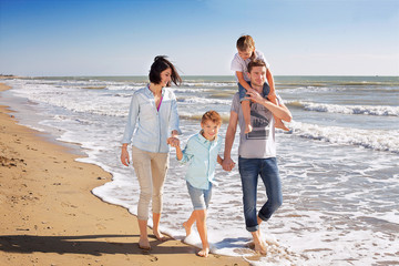 Small Family Walking at the Beach