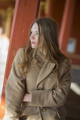 Woman in beige coat with long hairs