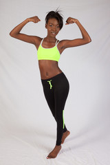 Black woman flexing her muscles