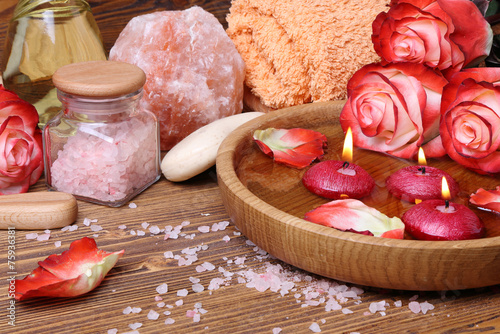 Spa concept with roses, pink salt and candles that float in wate - 75936381