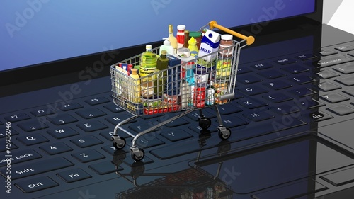 Keuken foto achterwand Boodschappen Full with products supermarket shopping cart on keyboard