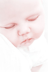 Close-up portrait of a sleeping baby.