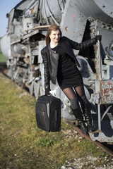 Woman hold on train with baggage