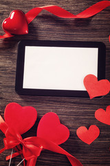 Tablet with red hearts