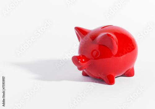 Red ceramic piggy bank or money box on white - 75939117