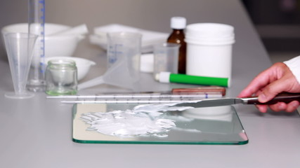 Scientist preparing a white paste