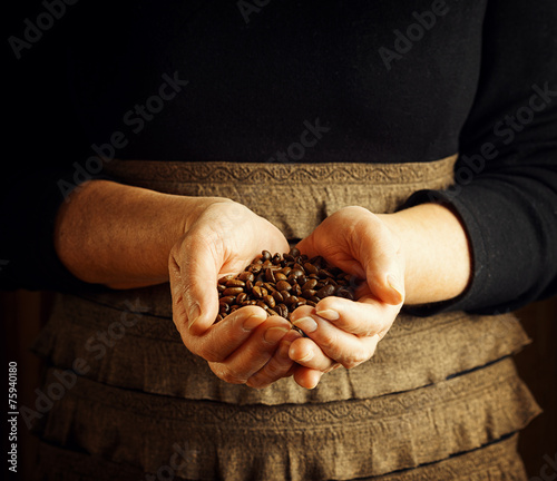 Senior woman holding coffee beans