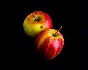 Red apple on black background