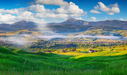 Colorful summer morning in the Carpathian mountain village