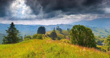 Summer landscape in the mountains before the storm