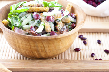 salad with beans, bacon, cucumber and croutons