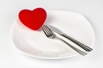 Red Heart shape on a white plate with clipping path