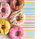 Fototapeta Colorful donuts on a striped napkin