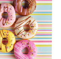 Colorful donuts on a striped napkin