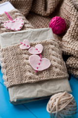 Two old pads in knitted cover with felt hearts