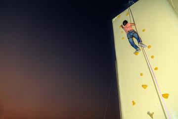 climbing a wall to reach the top.