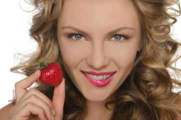 Young woman with strawberry in hands