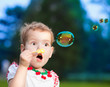 Cute girl with bubbles in the park